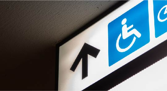 A sign with disability logo